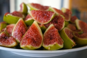 The delicious pink flesh of the green fig, quartered and ready to be cooked into jam.