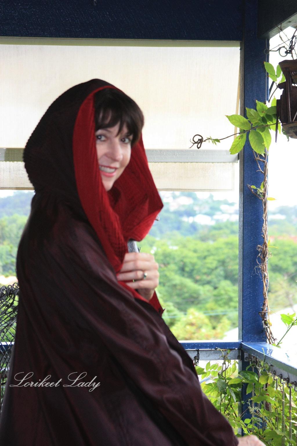 Susie in raincoat hood