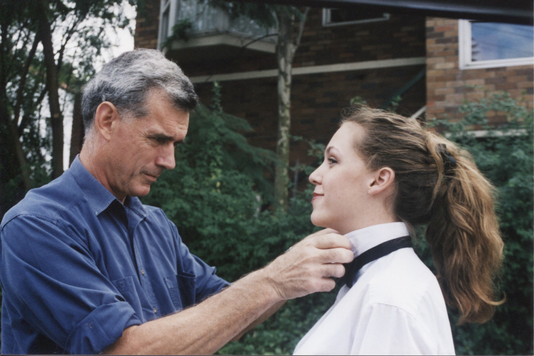 Andy teaching Sophie to tie a bow tie